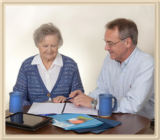 Real Estate Agent Working with Senior to Plan Moving
